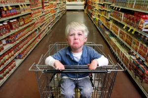 Kid crying  in a shopping cart